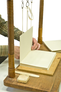 Bookbinder at work, traditional hand sewing