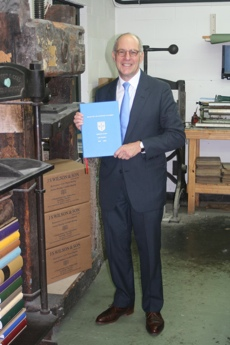 Loyd Grossman OBE collecting his Cambridge Ph.D. thesis from our workshop.
